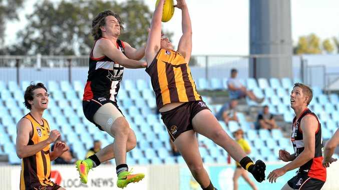 Mackay City Hawks player Taj Marshall attempts a mark against North Mackay Saints.