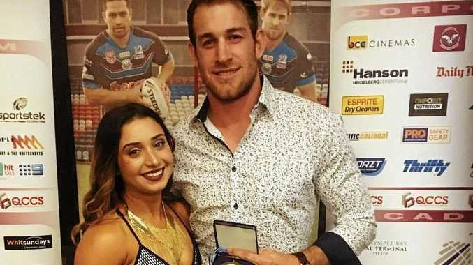 TOP SPOT: Andrew Daveys won Cutters player of the year. Pictured here with his girlfriend at the awards night.