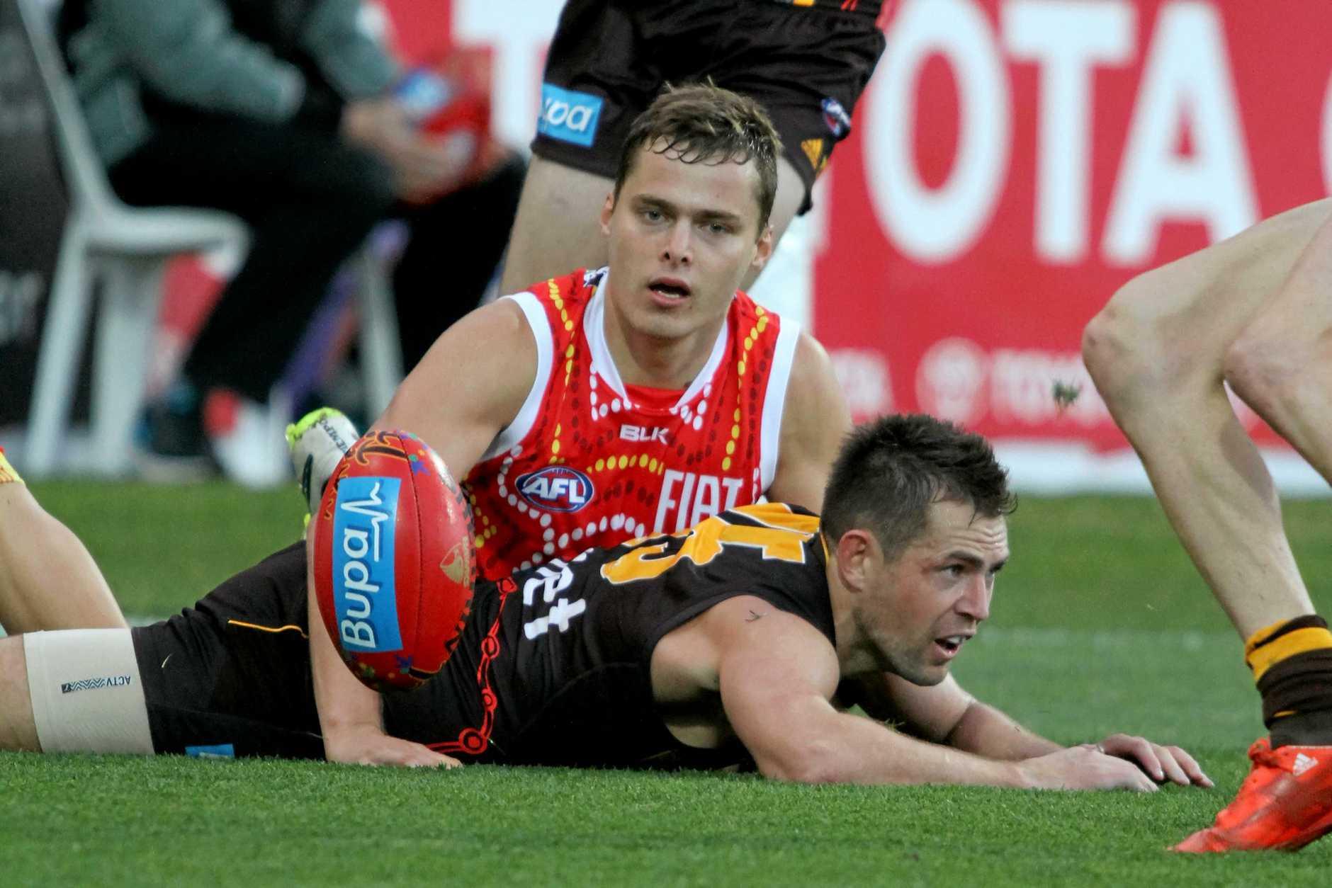 Luke Hodge (right) could yet be lining up alongside Gold Coast's Kade Kolodjashnij