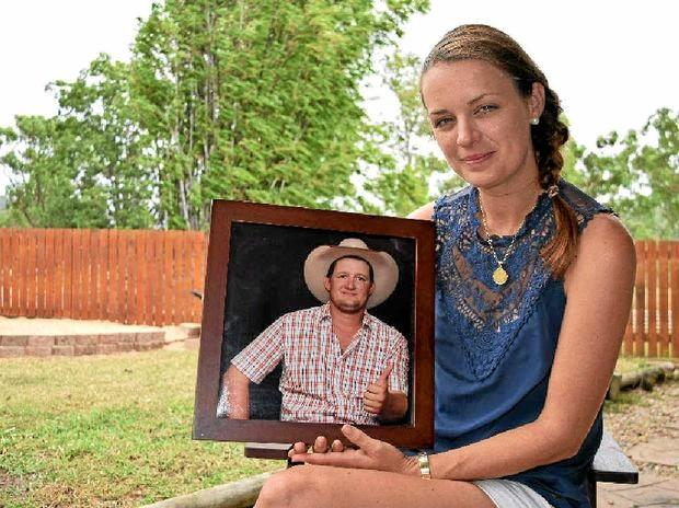 ALWAYS REMEMBERED: Amanda Golding holds a photo of her late fiance Bryson Mayne, who died in a workplace accident in 2014.