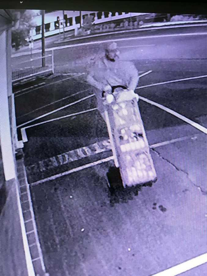 A man was spotted on CCTV wheeling three milk crates from Pump@123 in Toowoomba on Monday morning.