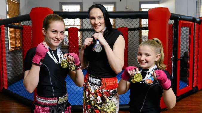 PUT 'EM UP: Real Life MMA fighters (from left) Brooklin Barrett, 13, Anita Vinson, and Brooke Boetje, 10, enjoyed success at the recent WAKO national championships in Sydney.