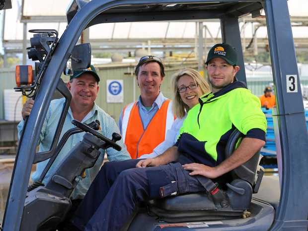 GOOD FIT: Withcott Seedlings CEO Mike Hindle (left) employs forklift operator Anthony Betts (right).