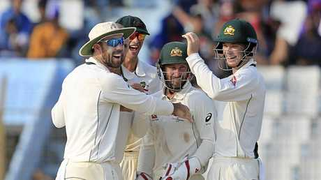 Australian players celebrate the dismissal of Bangladesh's Sabbir Rahman