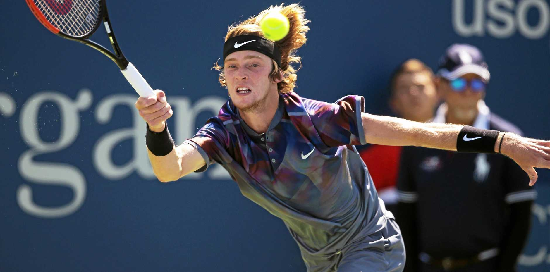 Andrey Rublev returns a shot from David Goffin during the fourth round of the U.S. Open