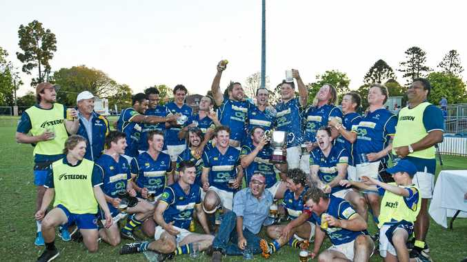 Departing Dalby coach Nathan Bradley (front centre) joins in the celebrations after the Wheatmen's grand final win last Saturday over Goondiwindi at Clive Berghofer Stadium.