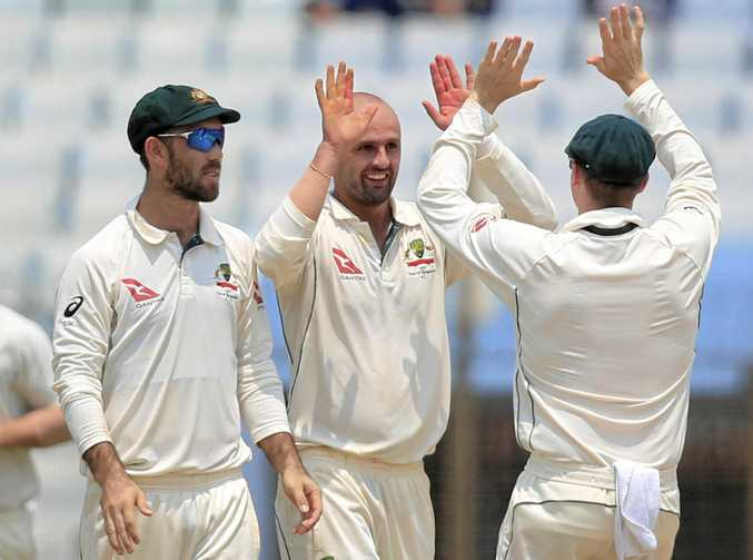 Australia's Nathan Lyon (second from right) celebrates with his teammates after the dismissal of Bangladesh's Soumya Sarkar.
