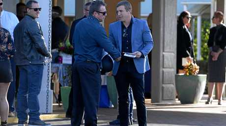 Trent Hodkinson (right) shakes hands with a mourner as he departs the memorial service for Hannah Rye.