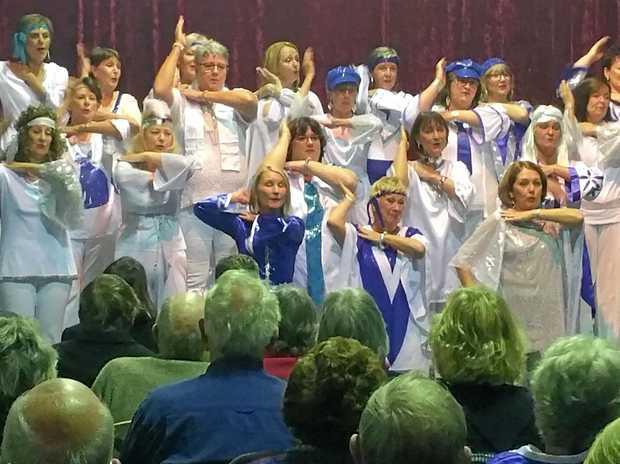 Headliners Chorus challenges the men in the Battle of the Barbershop.
