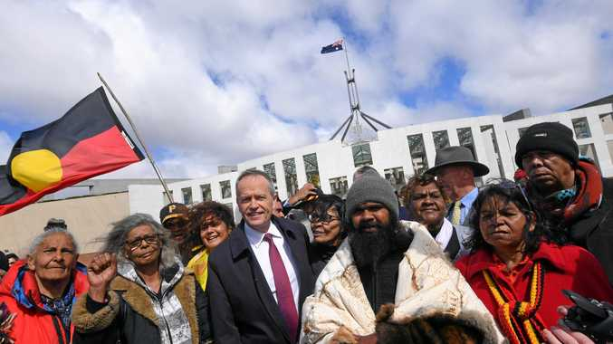 Opposition Leader Bill Shorten meet with Clinton Pryor (in skins cloak) and Aboriginal elders outside Parliament House in Canberra.