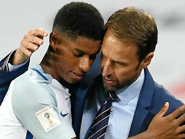 England head coach Gareth Southgate (right) hugs Marcus Rashford during the FIFA World Cup qualifier against Slovakia at Wembley.