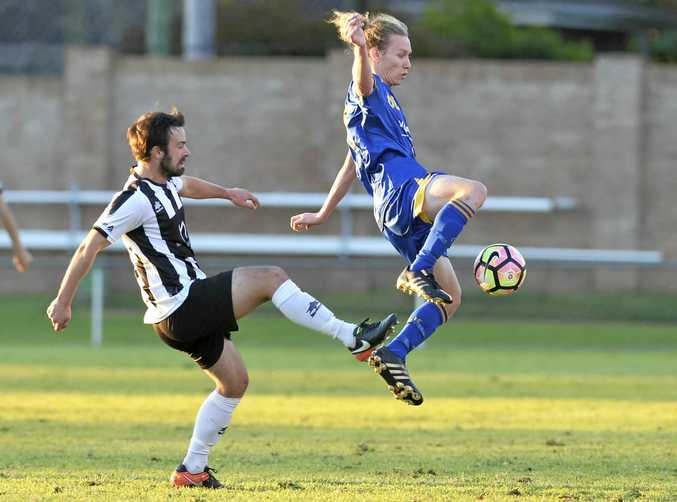 CONTEST: Willowburn Nicholas McGauley and USQ's Jedd Sugden in action in the TFL President's Cup at Clive Berghofer Stadium.