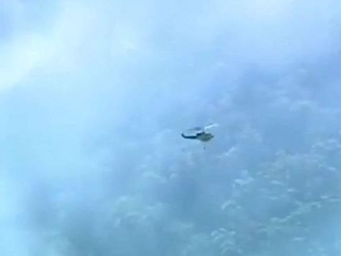 A water bomber fights an out-of-control fire in the Gold Coast hinterland at Cedar Creek. Photo: Nine Gold Coast News