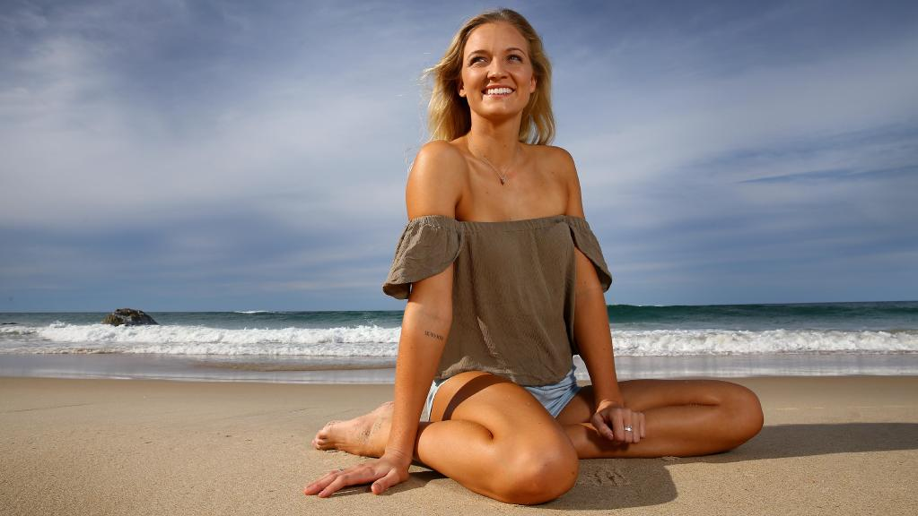 Emma Carey on North Burleigh Heads Beach, who became paraplegic after a skydiving accident in 2013 and can now walk again.