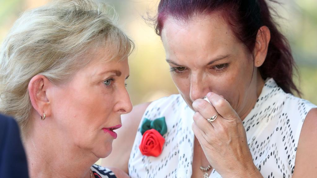 Mudgeeraba MP Ros Bates comforting Shelsea Schilling's mother Bonnie Mobbs outside Southport Court.