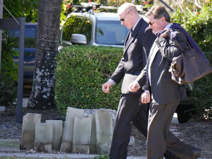 Steven Thomas Darby, 47, of Canberra, leaves Hervey Bay District Court with his lawyer.