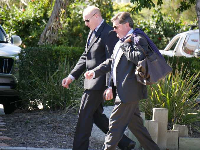 Steven Thomas Darby, 47, of Canberra, (left) leaves Hervey Bay District Court.