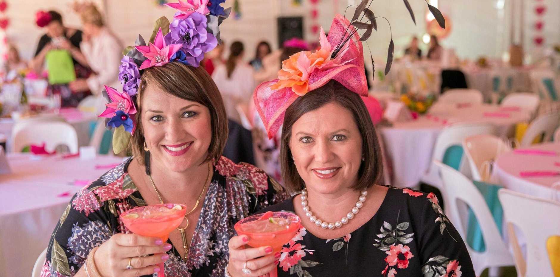 Weengallon Pink Ladies Day speaker Pamela Schramm (left) has fun with her sister Margret Lane.