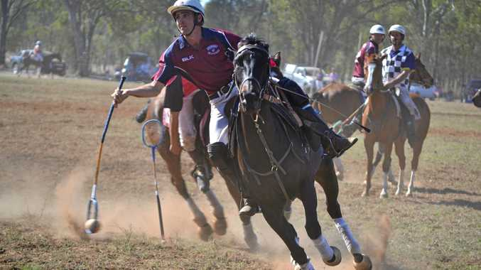 UNBEATABLE: A Tansey player catches the ball in a match against Chinchilla at the State Polocrosse Championships.