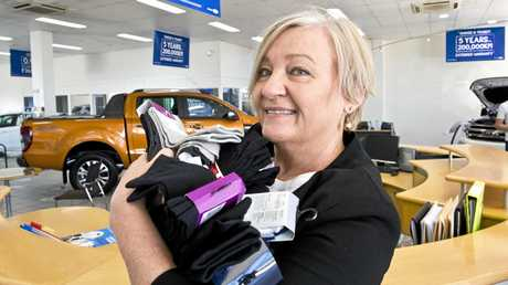 GOOD CAUSE: Linda McKenzie donates socks to the homeless at the launch of Hike for Homeless at Armstrong Ford, which is the hike's major sponsor.