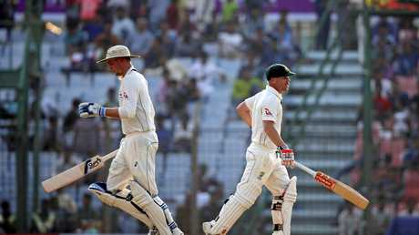 Australia's Peter Handscomb, left, and David Warner run between the wickets