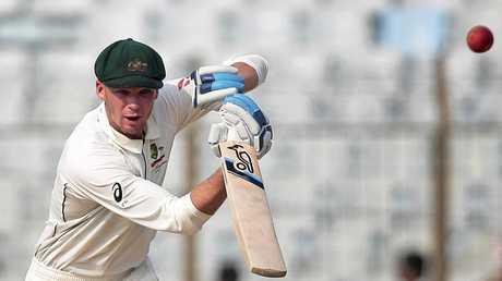 Australia's Peter Handscomb plays a shot