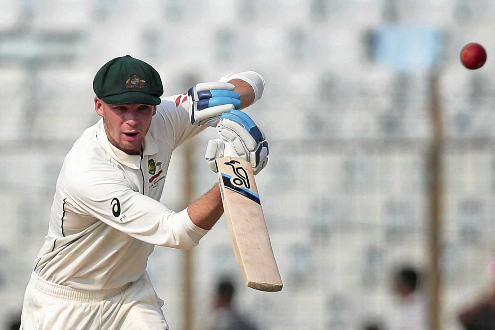 Australia's Peter Handscomb plays a shot during the second day of their second test cricket match against Bangladesh in Chittagong, Bangladesh, Tuesday, Sept. 5, 2017. (AP Photo/A.M. Ahad)