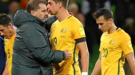 Postecoglou consoles his players after the narrow win over Thailand.