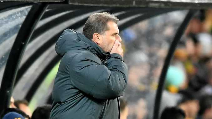 Socceroos coach Ange Postecoglou reacts after Thailand scores a goal.