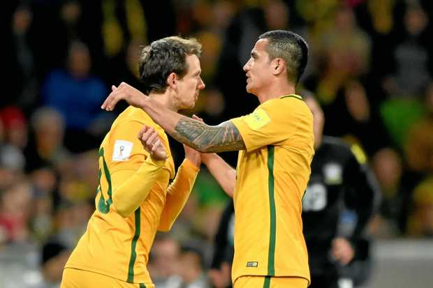Robbie Kruse (left) comes on for Tim Cahill of the Socceroos during the 2018 FIFA World Cup Qualifier between Australia and Thailand at AAMI Park in Melbourne, Tuesday, September 5, 2017. (AAP Image/Joe Castro) NO ARCHIVING, EDITORIAL USE ONLY