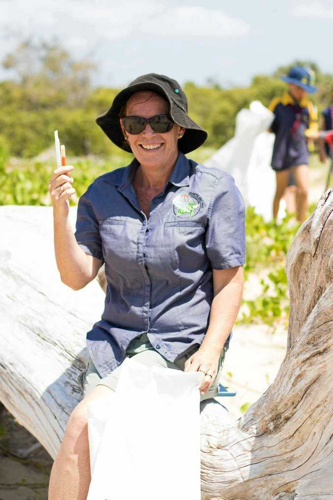 Plastic Bag Free coordinator Jo Stoyel with some plastic at the Farnborugh Beach clean up day some years ago.