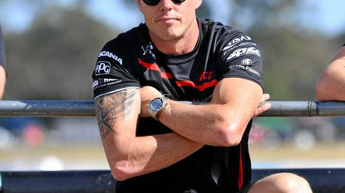 James Courtney in the Mobil 1 HSV Racing team Holden Commodore looks on during practice for the Ipswich SuperSprint round of the V8 Supercars Championship at Queensland Raceway in Ipswich, Friday, July 28, 2017. (AAP Image/Darren England) NO ARCHIVING, EDITORIAL USE ONLY