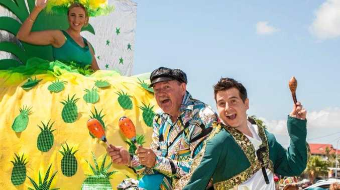 IN FULL FRUIT: This gigantic pineapple float in last year's Pinefest Street Parade was an eyestopper. On board were Lions (keft) Katie McCray, Don Knowles and Nigel Hutton.