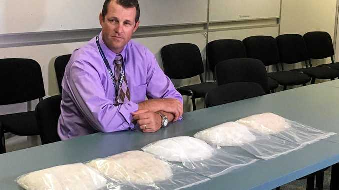 ICE SEIZURE: Rockhampton Police Criminal Investigation Bureau officer-in-charge Detective Senior Sergeant Luke Peachey with 5kg of ice.