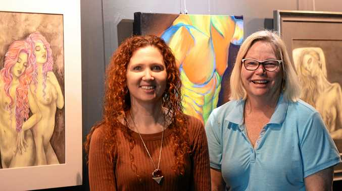 COLOURFUL WORKS: Nora Hanasy and Sandy McLean are hanging works for the Dim the Lights exhibition.