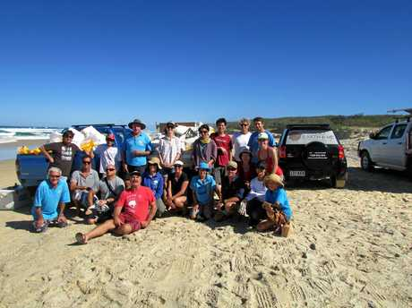 COMING CLEAN: The Surfrider Foundation Sunshine Coast volunteers with Clean Up Australia's Joe Jurisevic after a mighty clean up on the north shore.