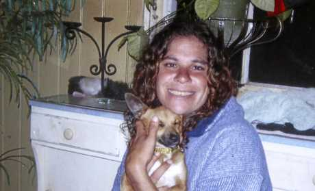 This 2010 photo released by the Daley family shows Lynette Daley cuddling her dog, Bunyip, in Australia. The brutal death of Daley, an Aboriginal woman, and the reluctance of officials to prosecute the white suspects, has highlighted a deadly racial divide in Australia, where Indigenous people remain the most disadvantaged segment of society. (Daley familya via AP Photo)