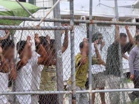 Asylum seekers at the Oscar compound in the Manus Island detention centre, Papua New Guinea in 2014. Picture: AAP Image/Eoin Blackwell.