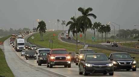 Traffic is seen heading North along the Florida Turnpike near Homestead, Fla., as tourists in the Florida Keys leave town (Al Diaz/Miami Herald via AP)