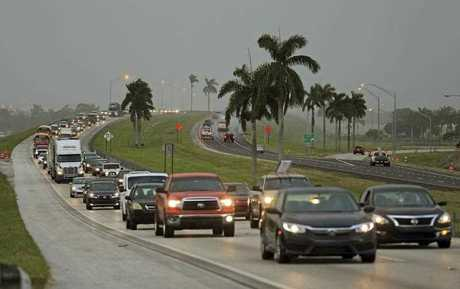 Traffic is seen heading North along the Florida Turnpike near Homestead, Fla., as tourists in the Florida Keys leave town (Al Diaz/Miami Herald via AP)