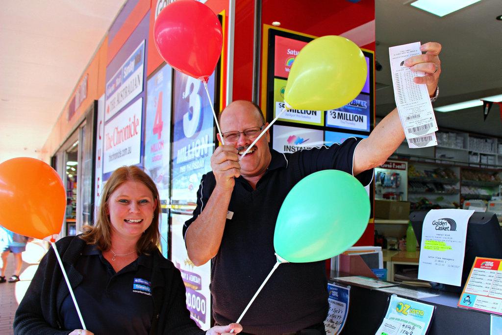 BIG WIN: Gatton Plaza News owner David Keys and employee Kylie Nawratzki celebrate selling the winning ticket.