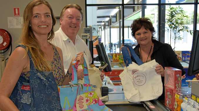 BAG IT: Boomerang Bags' Desiré Gralton, Noosa MP Glen Elmes and Peregian IGA owner Roz White.