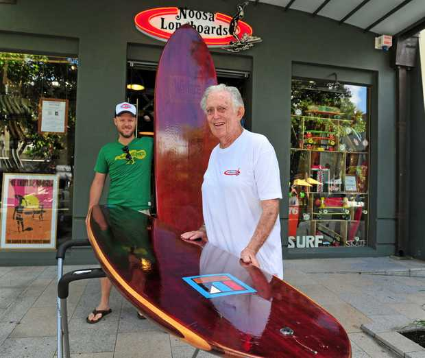 LEGEND: Bill Wallace (front) and Peter Cullen at Noosa Longboards with the last two sufboards made by Bill.