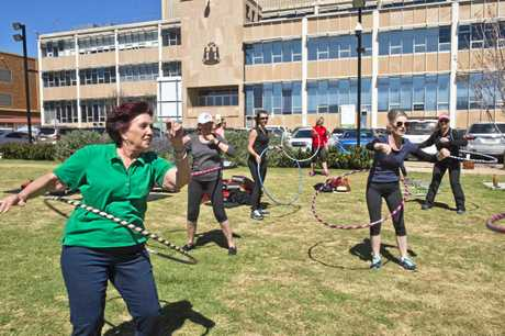 Enjoying hula hooping are (from left) Toowoomba region councillors Carol Taylor, Nancy Sommerfield and Megan OHara Sullivan.