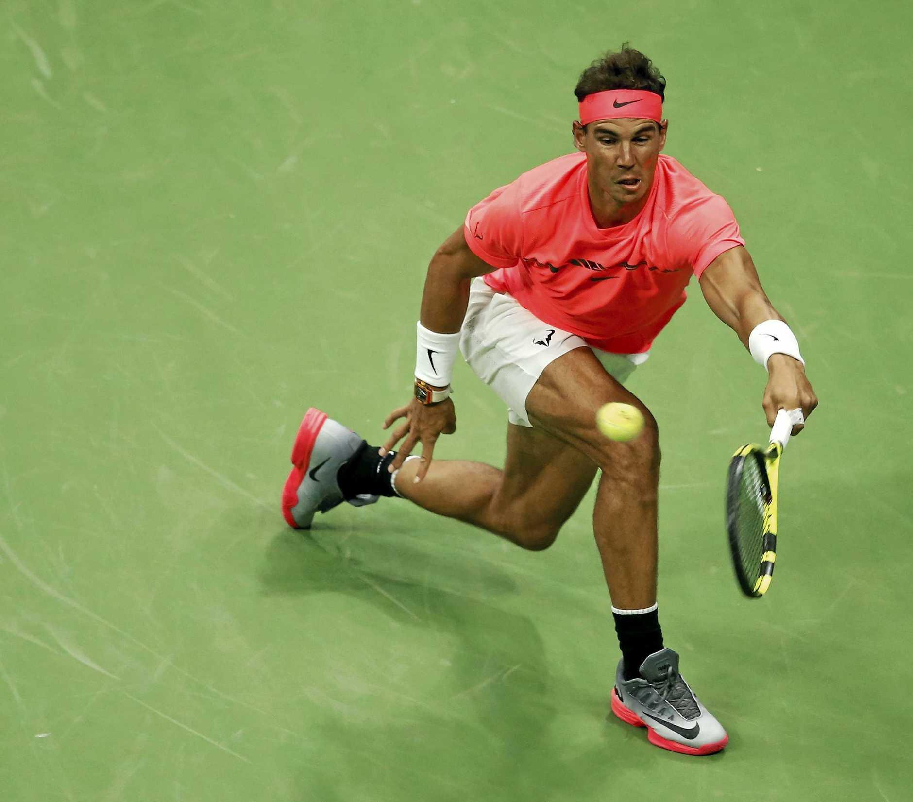 Nadal returns a shot to Andrey Rublev