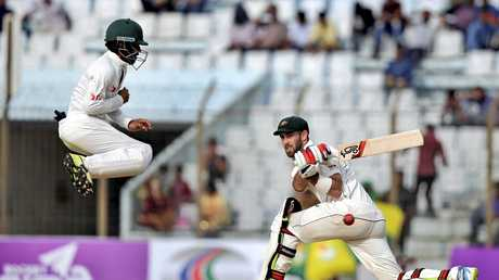 Glenn Maxwell plays a shot, as Bangladesh's Mominul Haque jumps to avoid getting hit