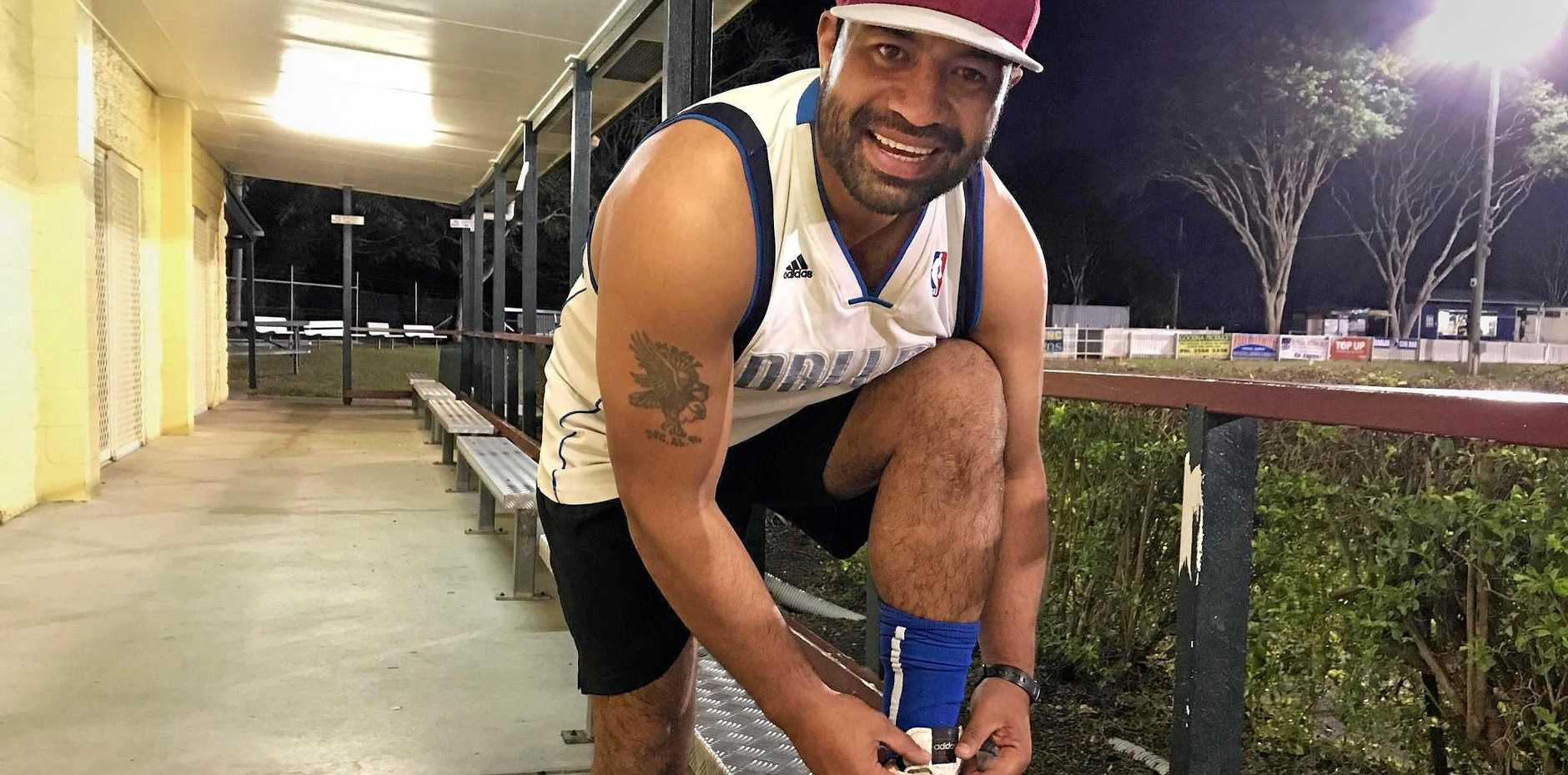 BOOTY: Alby Talipeau puts on his Adidas boots at training ahead of the grand final on Saturday, a far better choice than the $2 cheapies he bought for his NRL debut.