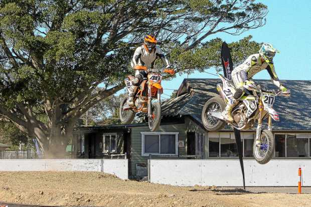 Proserpine's Andrew Mcliesh (right) racing at the Newcastle international Supermoto at the weekend.