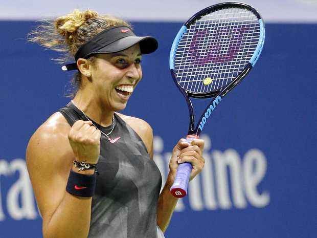 Madison Keys, of the United States, reacts after defeating Kaia Kanepi, of Estonia, in the quarter-finals at the US Open.