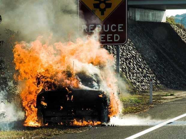 UP IN FLAMES: A car was swallowed by fire on the Sunshine Mwy on Monday afternoon.